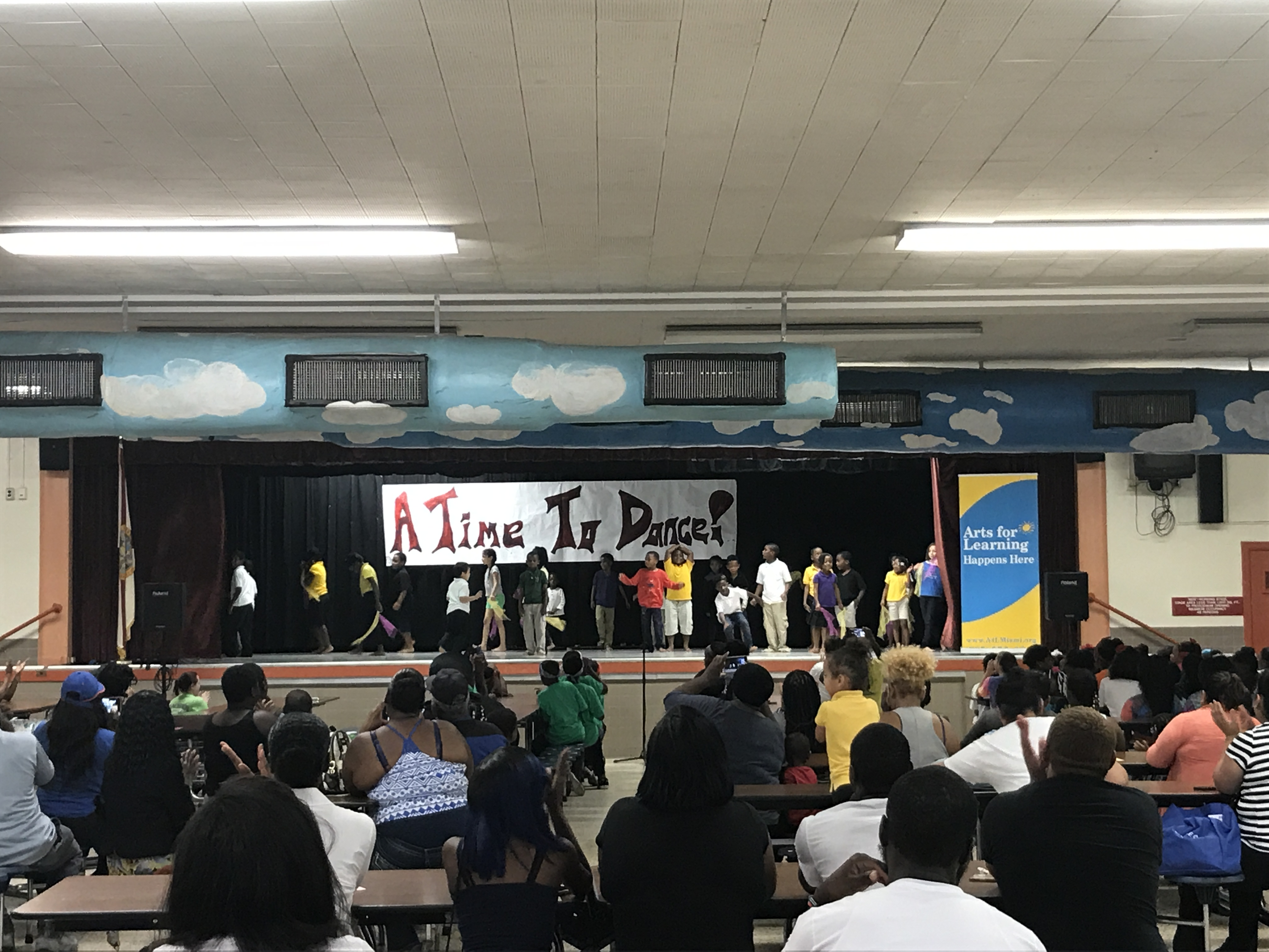 """A cafetorium full of proud family and friends at """"A Time to Dance!"""" at Dr. Henry W. Mack/West Little River K-8 Center."""