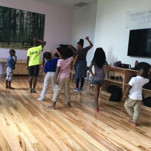 Young boys and girls in dance class with teaching artist.
